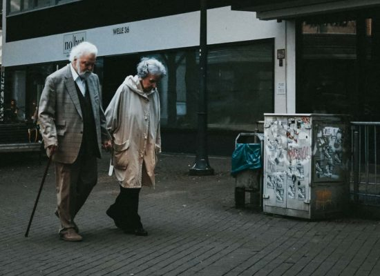 Older couples walking together on a city street