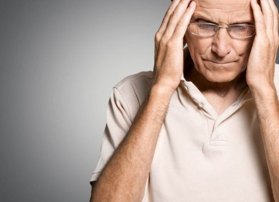 Older man experience stroke-related symptoms