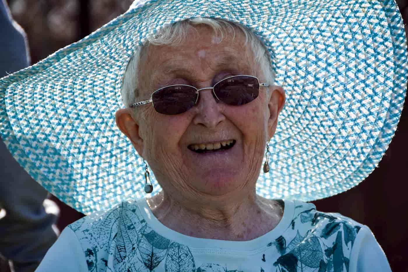 Older Women wearing a sun hat for sun safety