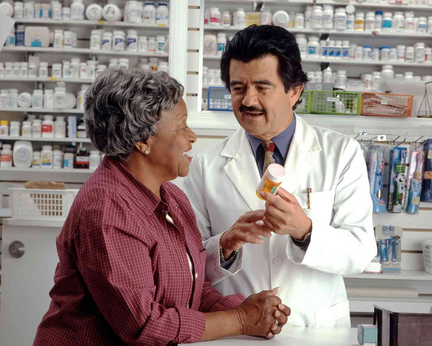 A woman discussing thyroid health with her doctor